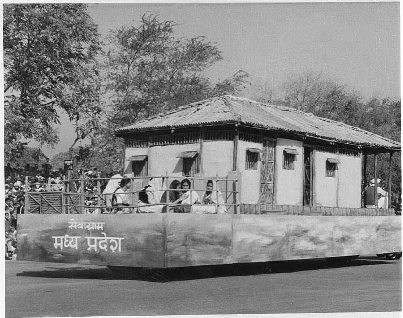 DPD/ Jan.' 56, A52h CULTURAL PAGENT IN THE REPUBLIC DAY CEREBRATION , AT NEW DELHI (1956) The tableau from Madhya Pradesh was a replica of Mahatma Gandhi's hut (Bapu Kuti) at Sevagram.