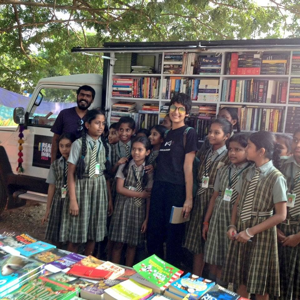 Schoolchildren visiting the mobile library at Khammam, Telangana.