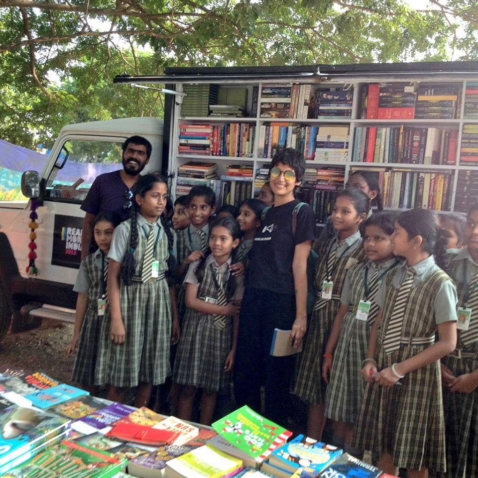 Schoolchildren visiting the mobile library at Khammam, Telangana.