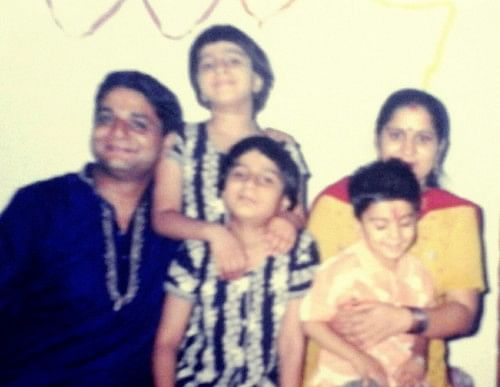 Pooja with her family when she was young.