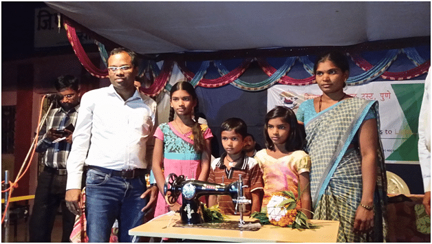 7.Sewing machine distribution to 10 more farmer widows at Sondo