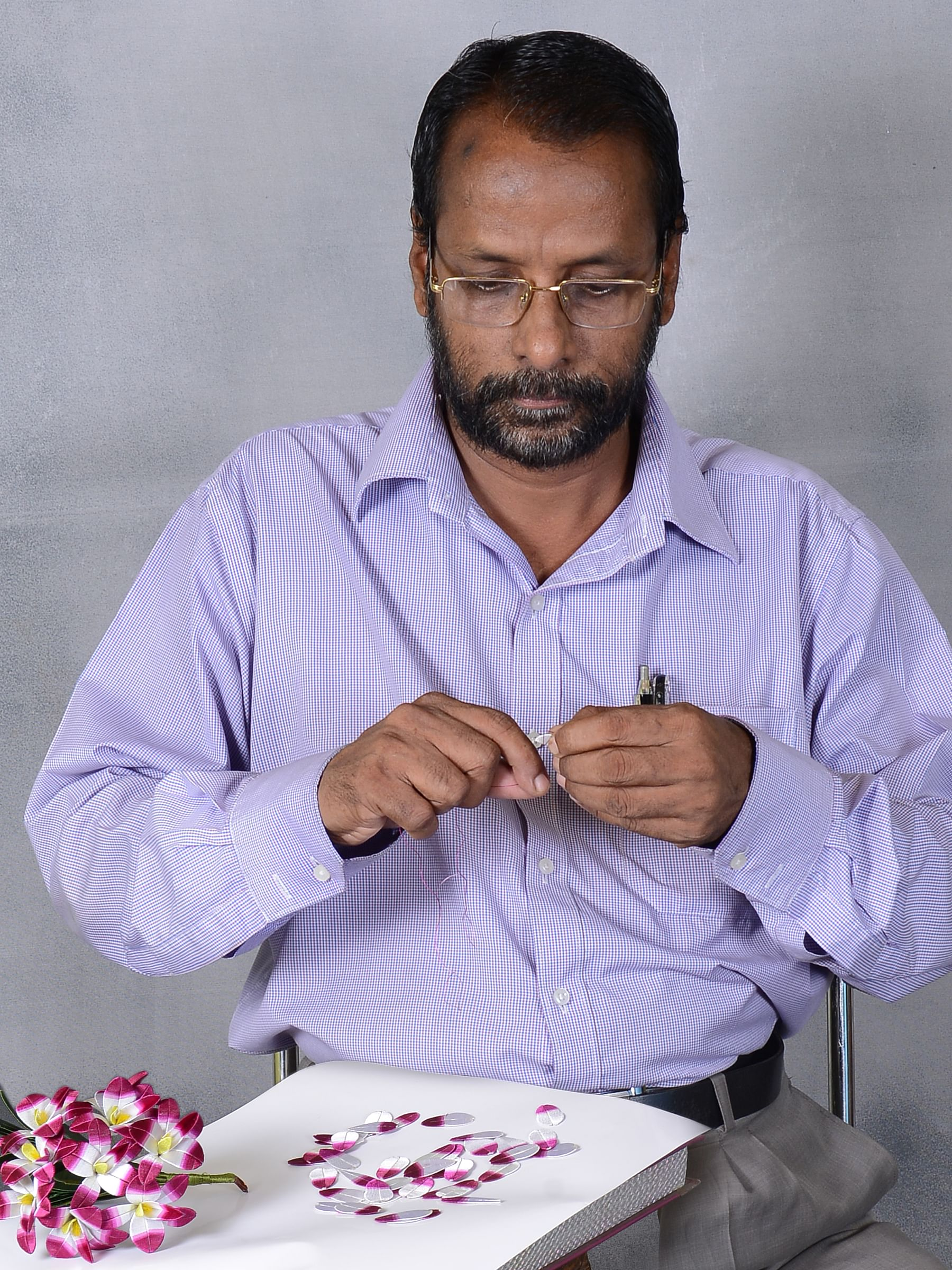 Antony Joseph making a bouquet of flowers. Photo Credit: Thread Garden