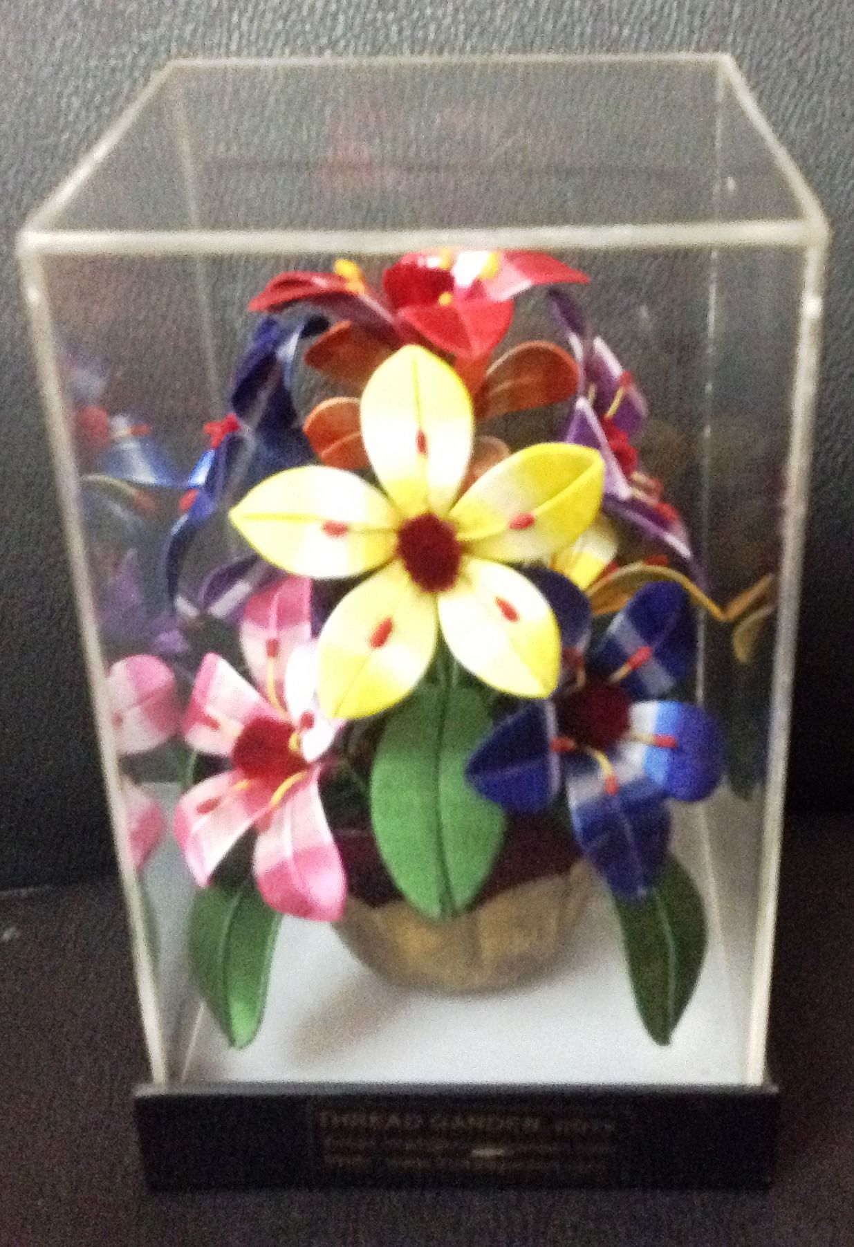 Encased in glass, flowers sold at the sales counter Photo credit: Aparna Menon