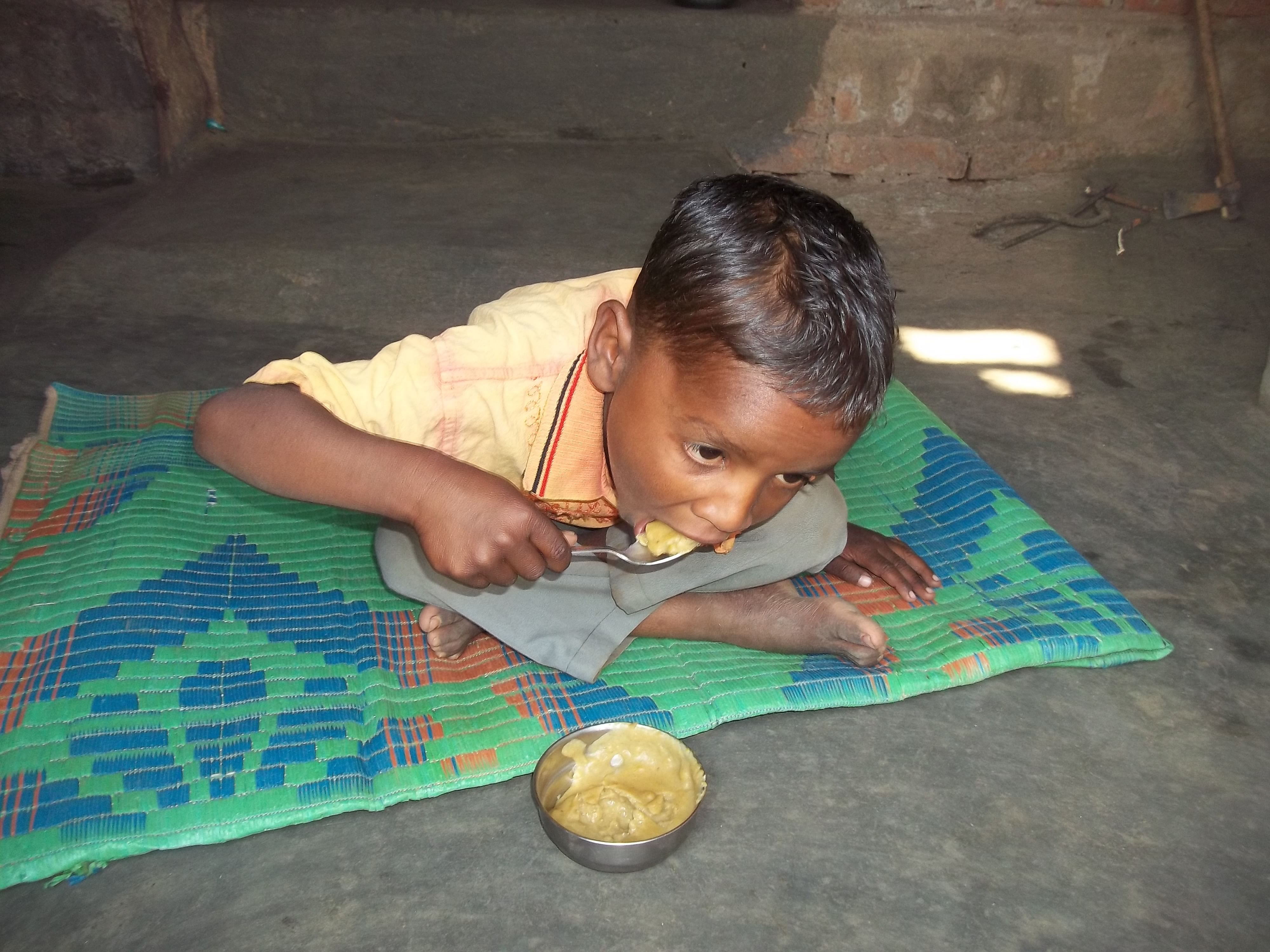 This is Pramod Majhi, whose mother Pramila ensures that she gives him 'tiranga bhojan' for every meal. Thanks to the sustained balanced input he has grown taller, his skin is clearer and his hair is black and thick. (Credit: Saadia Azim\WFS)