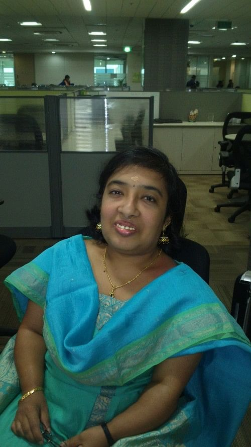 Pradha in mobile chair in office