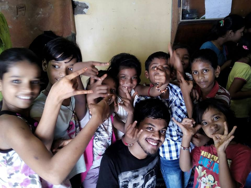 children with the volunteer after one of the sessions