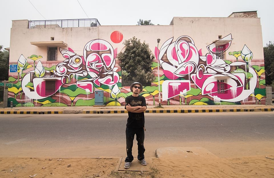 """The Lotus' by Suiko. In this piece Suiko takes the national flower of India - the lotus and re-imagines it with his signature of curved lines and Japanese characters to create this mural for the Lodhi Art District."""