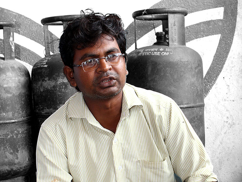 Rajendra Verma runs a cooking gas distribution agency in Birni. Photo: Vimages