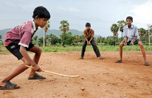 Image for gilli danda game, stick games, Nostalgic Games getting replaced by modern games, old past-times, 90s Nostalgic Games