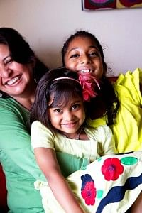 Malini with her adopted daughters