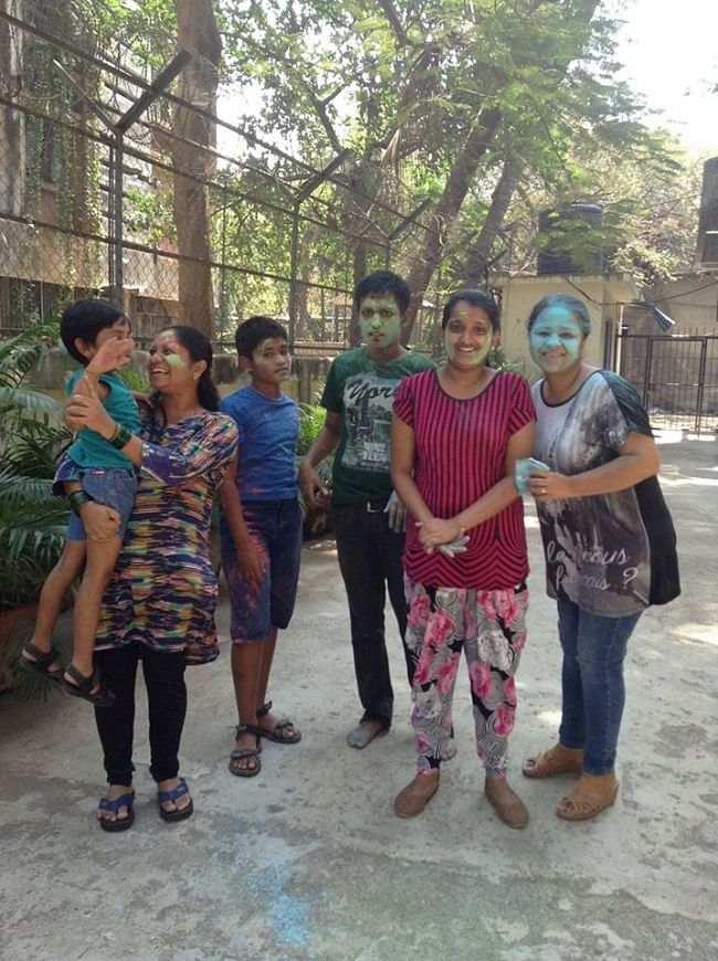 Children and teachers at SAI Connections enjoying Holi