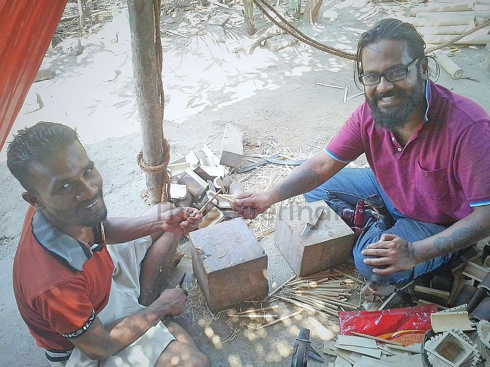 Ankush (right) with a resident of the village