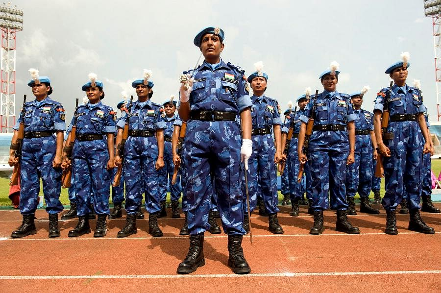 Members of the all female Indian Formed Police Unit (FPU) of the United Nations Mission in Liberia (UNMIL) stand ready to receive medals, in recognition for their service. 12/Nov/2008. UN Photo/Christopher Herwig. www.unmultimedia.org/photo/