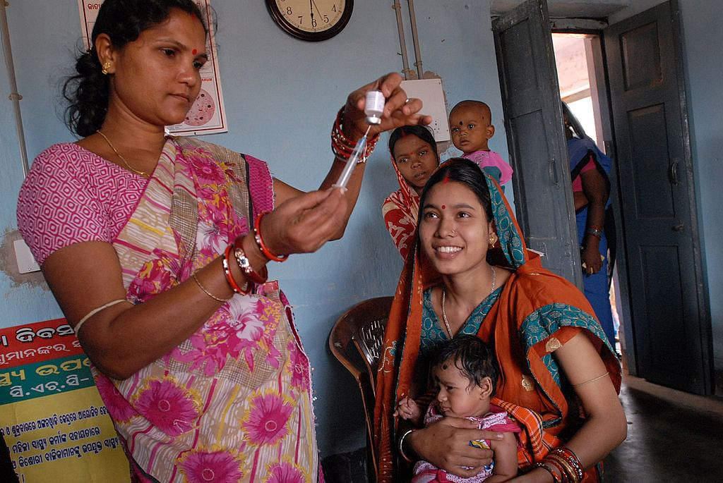 1024px-Community_health_worker_gives_a_vaccination_in_Odisha_state,_India_(8380317750)