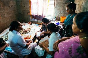 The Pallium India team on a home visit