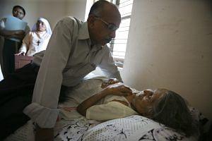 Dr Rajgopal with a patient