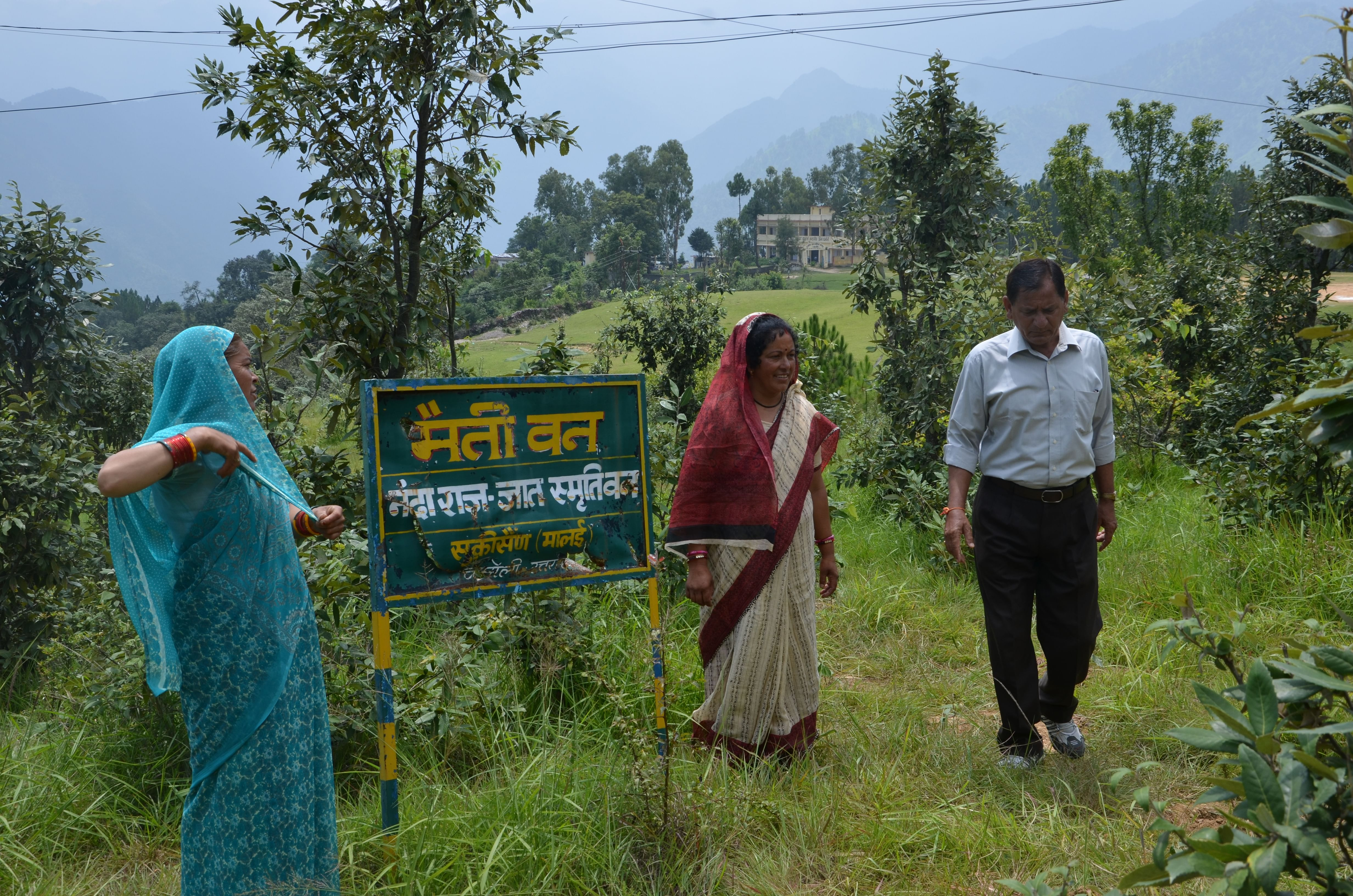 Sulochana (left) and Devaki (middle) with Kalyan Singh at the 'Maiti Van' near their Bagoli village in Chamoli district. It was Singh who started this unique tree plantation drive. (Credit: Nitin Jugran Bahuguna\WFS)