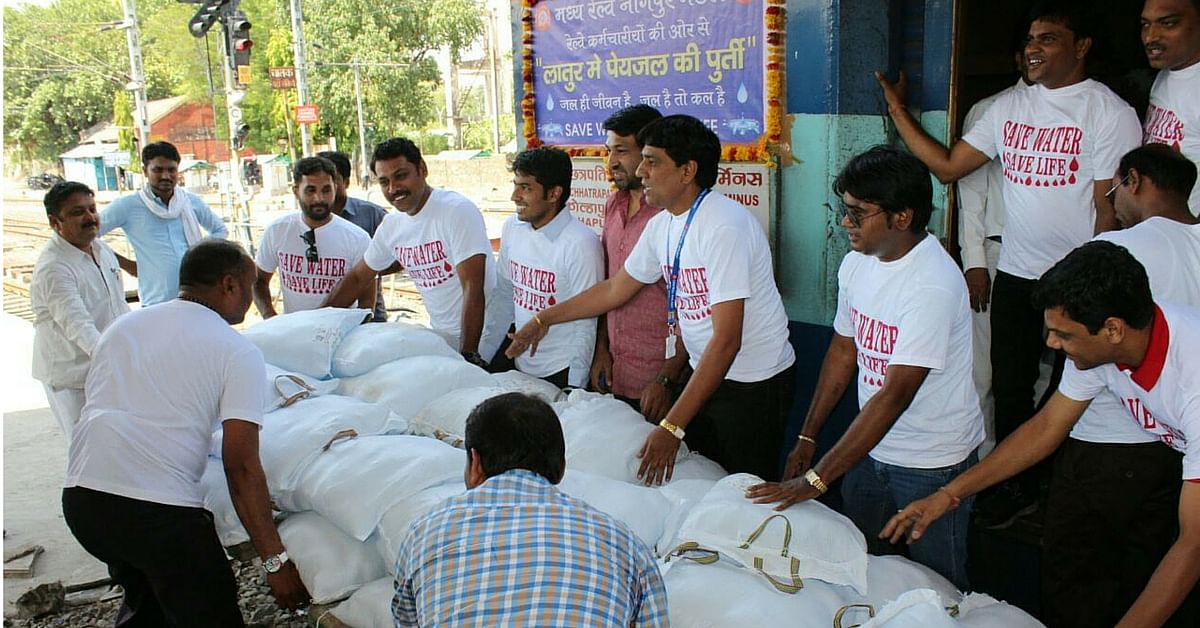 Employees of Central Railway from Nagpur transporting bags containing water pouches in Nagpur-Kolhapur Express