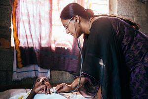 A doctor with Pallium India on a home visit