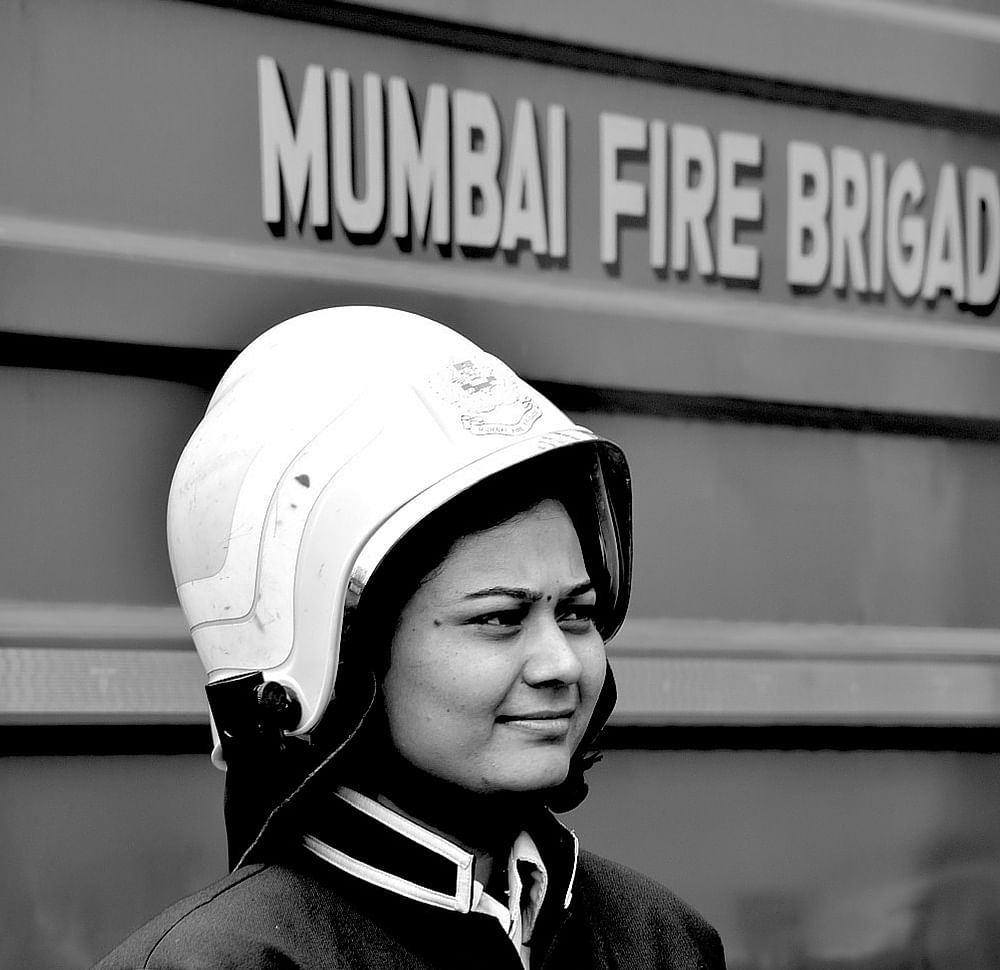 "Fire Fighter: The first question I asked her was ""do you have different duties because you are a woman"" to which she promptly replied, ""In a uniform, there is no man or woman, we are saving lives and work as a team""."