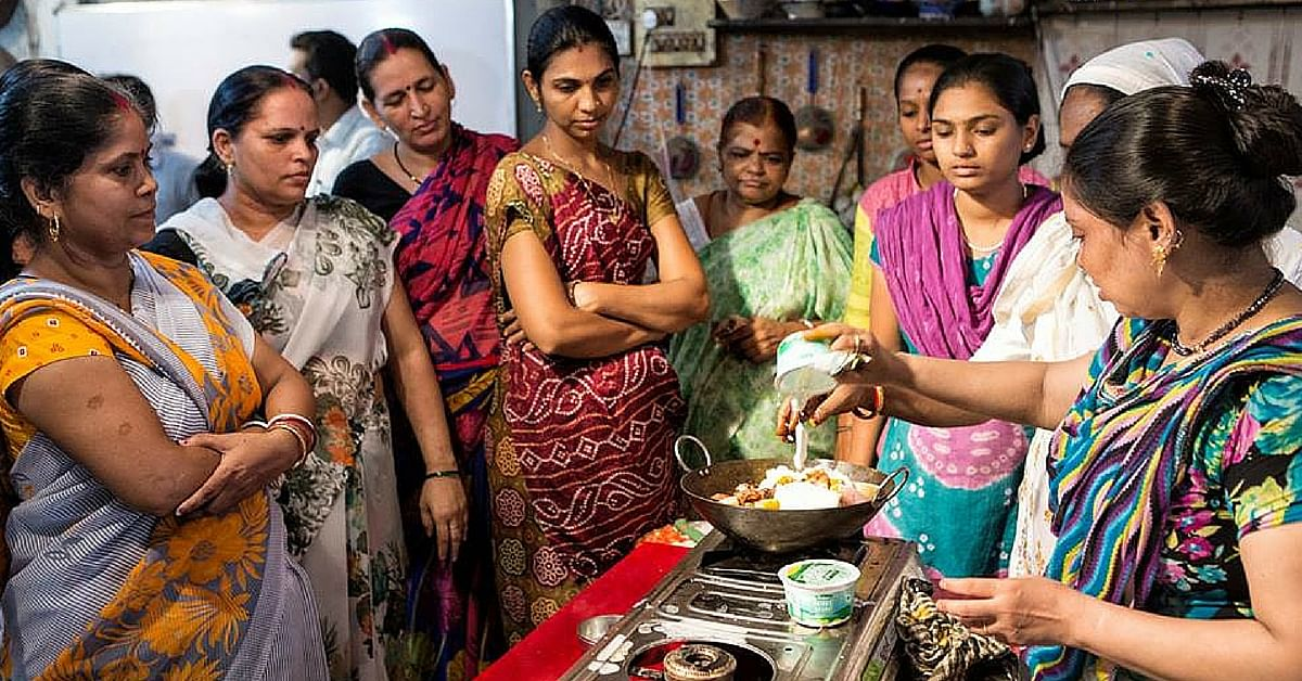Rizwana Qureishi, one of the cooks in the book, showing the group how to make her wicked marinade for Chicken Biryani.