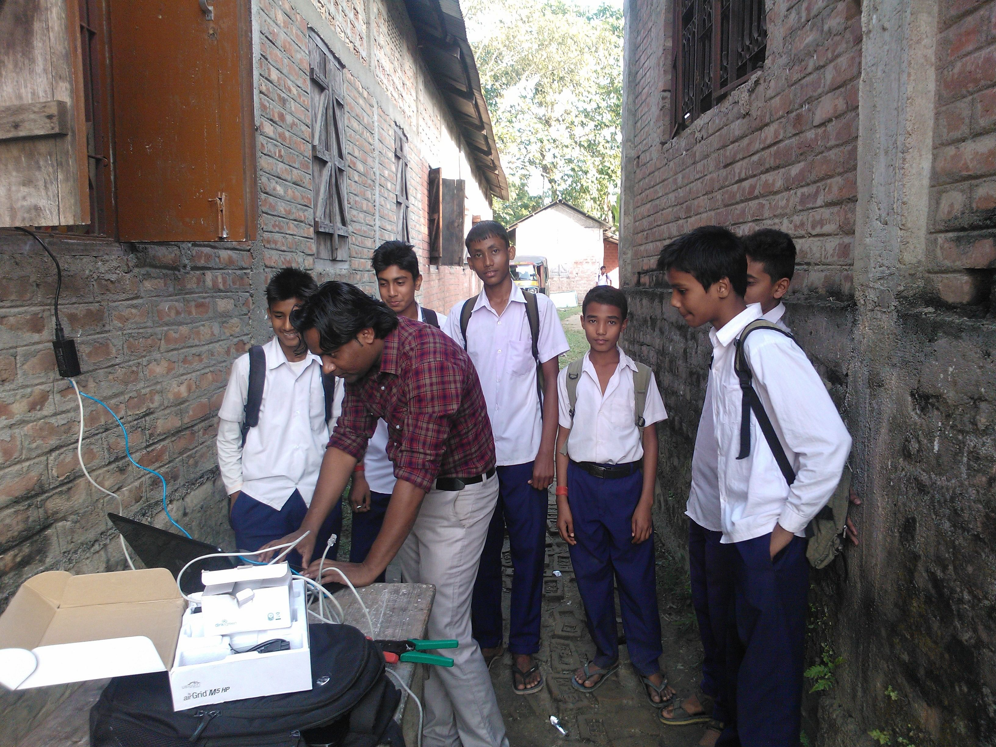 Mudassir teaching computing to rural school children