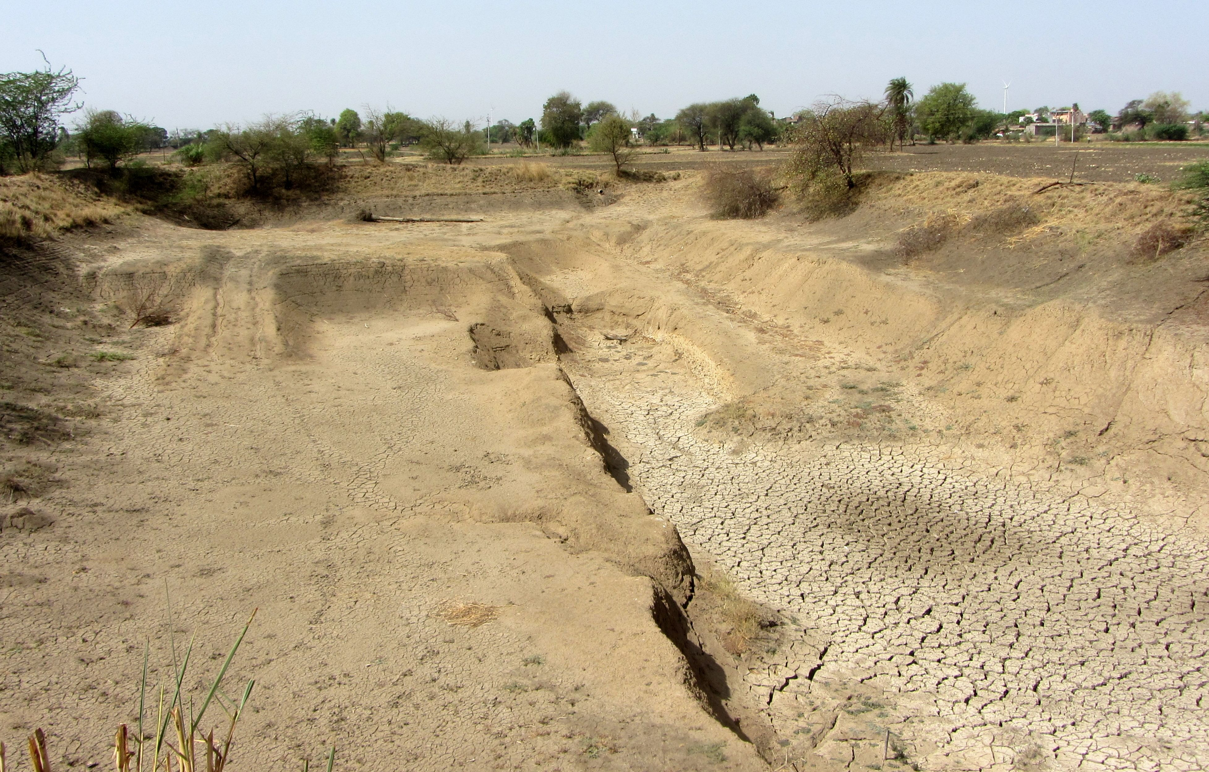 Farm pond of Singhs in the process of being deepened at Harnawada.