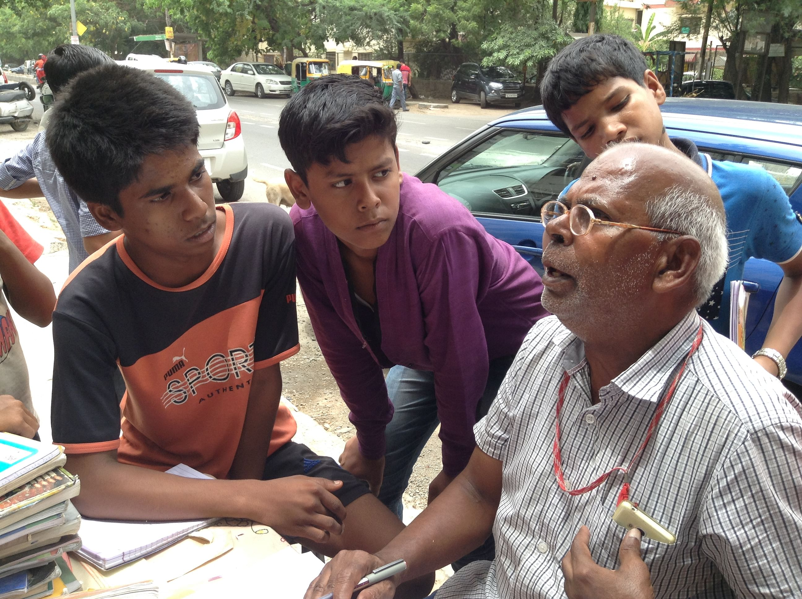 Uncleji teaches from his heart and the children listen intently