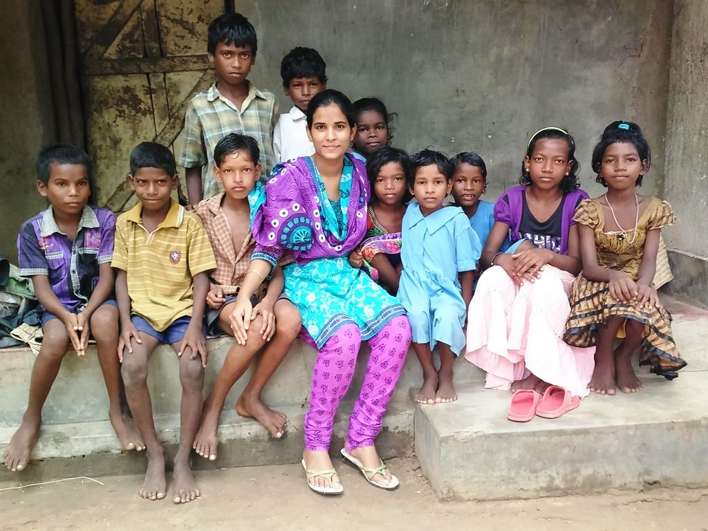 Maya with underprivileged children