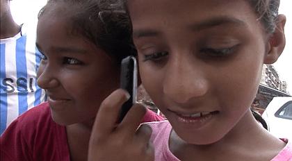 Children in Dharavi using the Hello, Seekho service