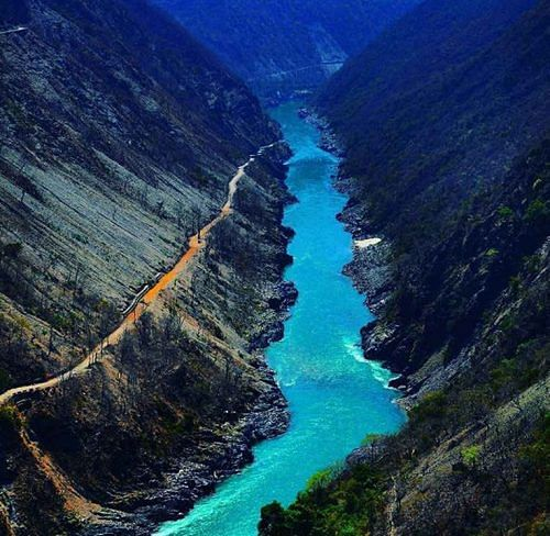 The river Ganga flowing between two mountains