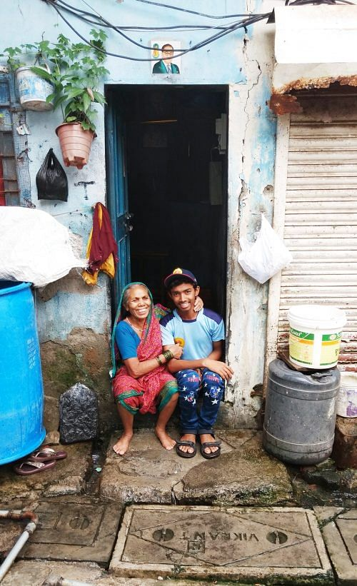 Nitin with his grandmother, outside their house.