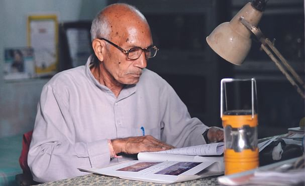 busy in one of his daily routine after prayer he comes to his office to check letters and to read newspapers.