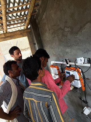 Anoop along with villagers at a water ATM