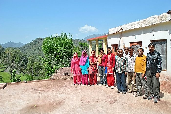 Ishira visiting a group of small holder farmers practicing terrace cultivation in Thakurdwara village in Pachhad tehsil. Image courtesy: Crop-Connect