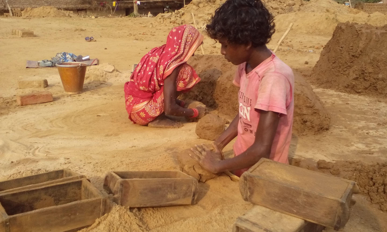 A child labourer at a brick kiln
