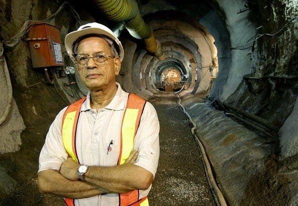 NEW DELHI, INDIA: Managing Director of Delhi Metro Rail Corporation (DMRC) E. Sreedharan, poses after watching a Rock Tunnel Boring Machine (TBM) break through the last tunnel section at Chawri Bazaar in New Delhi, 03 September 2004. The 11 km long underground corridor of the Metro running from Delhi University and Central Secretariat (line II) involves tunnelling over a distance of 4 kms using a TBM and Earth Pressure Balance Machine (EPBM). The undergroung Metro Corridor is being openied in two stages with the 4 km Delhi University to Kashmere Gate section being opened in December 2004, and the extension to the Central Secretariat opening forecast for June 2005. AFP PHOTO/Prakash SINGH (Photo credit should read PRAKASH SINGH/AFP/Getty Images)