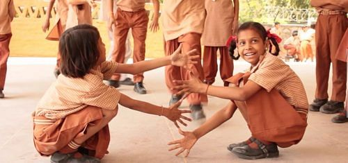 Differently abled girls playing together