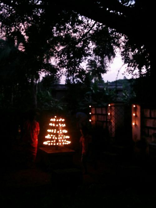 A tiny village temple lit up for the evening.