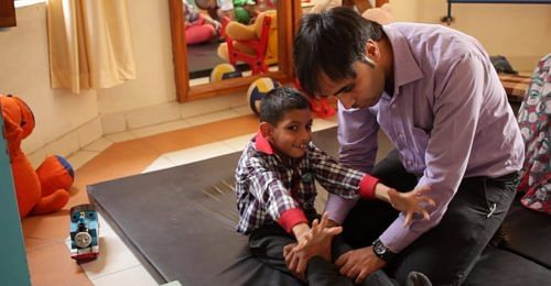 Physiotherapist helps a differently abled boy