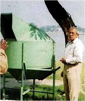 Mr. Ghosh with his previous model of the midsize bin. It is made of fibre glass and is still used at Ramakrishna Belur Math, West Bengal.