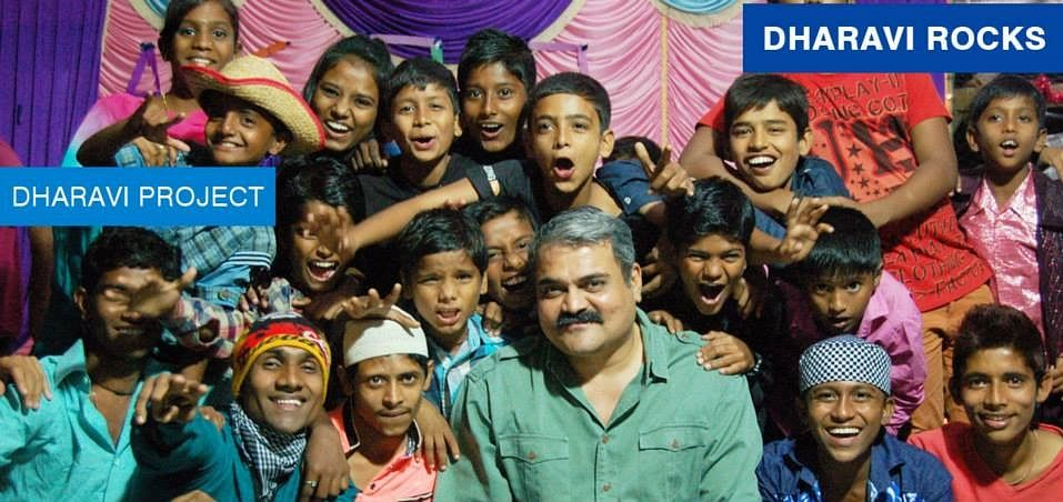 Vinod Shetty with the children of Dharavi Rocks band