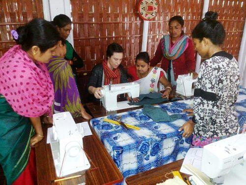 American designer Kristine Gottilla with women artisans at Bokakhat.