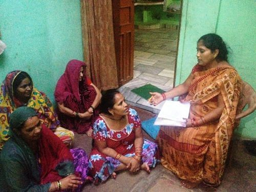 Sangeeta Awasthi speaks to her neighbours about availing benefits under the Swachh Bharat Mission to build toilets.