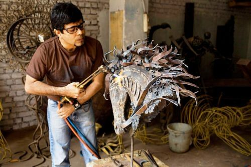 Unlike most people Arzan Khambatta does his best work when surrounded by waste.