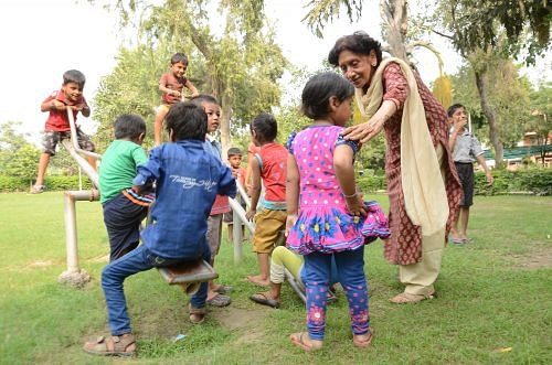 Meena playing with the children