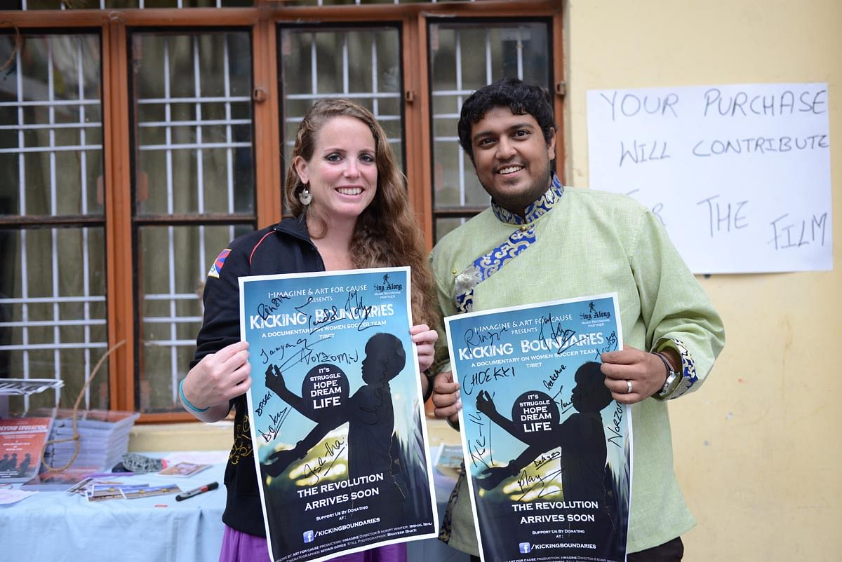 Director Irshal Ishu and football coach Cassie Childers pose for a photo in McLeod Ganj, India, on 6 October 2013.