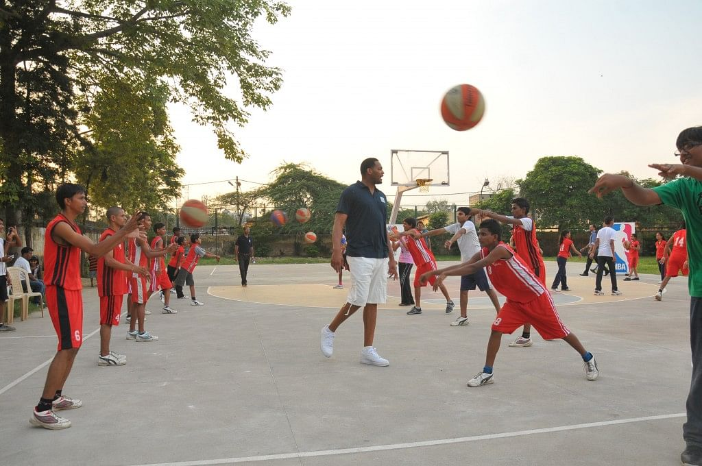Indian kids playing basketball