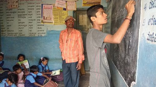 Kashinath explaining math at a child activity centre