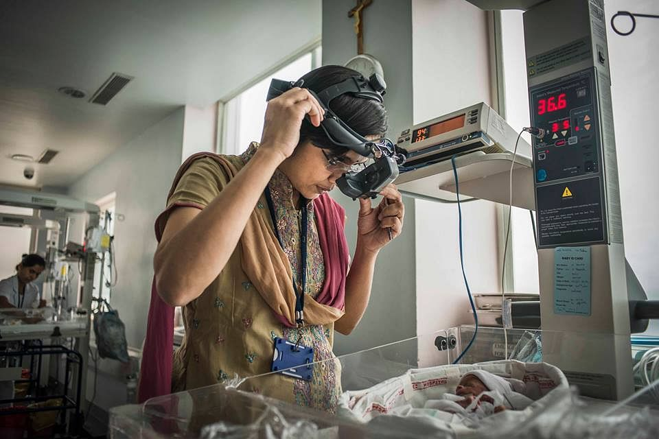 Dr Padmaja Rani of LVPEI prepares to screen a baby.